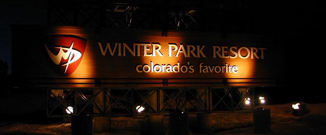 Winter Park Shuttle entering the resort at night.